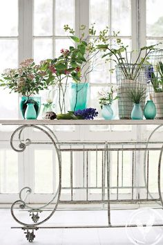Stunning marble top wisteria table topped with distressed wire ware and stunning Azzure & Alza frosted bottles. www.frenchcountry.co.nz