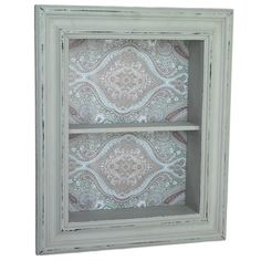 small wall cabinet with glass door and wallpapered