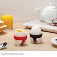 Sumo Egg Cups | Cool People Shop With this pair of red and black sumo egg holders, you can start a little-but-tasty food fight of your own. And remember, the winner breaks it all!  ure, you may be able to snap their tops off with the sharp tap of a spoon, but these little guys are still tough.  #sumo #kitchen #cooking #breakfast #gadget #egg #cup #kitchen #gadget #sumoeggs