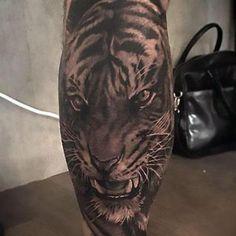 Black and Gray Tiger on Calf Tattoo Idea
