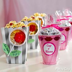 Indulge sweet tooths with DIY treat cups! Click the pic to see how to make their hearts POP with a popcorn-n-lolly treat and a cup o' kisses!