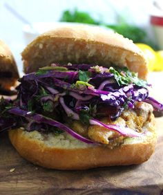 This cumin rubbed chicken sandwich is served with a delicious herby chimichurri slaw and a spicy chipotle potato salad!