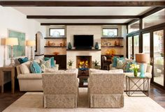 Living Room -- beams, furniture arrangement. balanced without being perfectly symmetrical (although it's close).