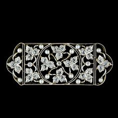 Turn of the Century Rose cut Diamond and Seed Pearl PinAn exqisite openwork jewel from the Edwardian period. Diamond set platinum leaves and stems bearing tiny pearl fruit combine to create this delicate, nature inspired treasure. Platinum over yellow gold. This brooch measures 2 inches long by 3/4 inch tall.The Diamonds are described as follows:Thirty Three Rose Cut DiamondsWeight: 1.00 carat total wieght