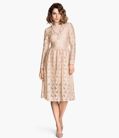 Long-sleeved dress in lace and jersey. Seam at waist, gently flared skirt, and visible back zip. Lined.