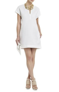 Every gal needs a little white dress in their closet. This fabric and cut is timeless and seasonless. Wear with black during fall/winter and pair with pops of color during spring/summer. Carissa Sheath Dress | BCBG