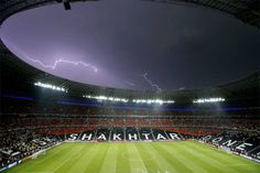 Weather beaten  Lightning flashes over the stadium after the weather suspended a Euro 2012 match between Ukraine and France in Donetsk, Ukraine on Friday.