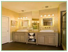 Gorgeous Large Bathroom Vanity Cabinets With Double Sink And Lighting Fixtures Over Mirror