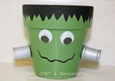 Turn a flower pot into Frankenstein & add a tea light for a spooky glow!