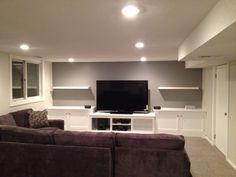 Basement remodel, decor still to be added. Custom built-ins, couch from HOM, shelves from ikea.