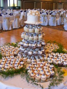 Wedding Cup Cakes: 20 red velvet, 20 white, 20 chocolate, 20 marble. Each has: 10 whip icing, 10 butter cream icing. Top cake mine and codys. White and pinapple with whip icing. Mixture of purple and yellow frosting, with opposite colored flowers on top. Top cake: purple frosting, yellow flowers. (double all depending guest number)