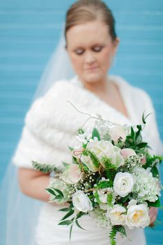 Winter white wedding bouquet. The National Press Club in Washington, D.C. Image by Vness Photography & Julia Rochelle.