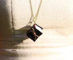 Miniature Leather Bound Book Necklace by TayrawrFortunePhoto