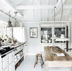 stand alone cabinet, farmhouse table, planked painted ceiling, etc. Purple Area: Kök
