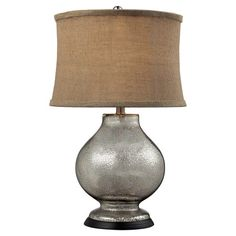 Cast a warm glow in your entryway or living room with this eye-catching table lamp, showcasing an antiqued mercury finish and taupe burlap shade.