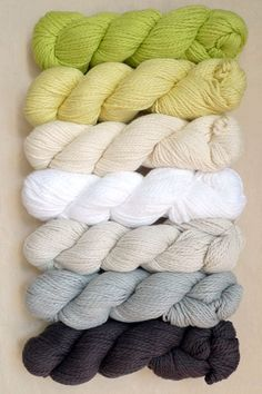 Blue Sky Cotton, 100% Cotton. These colors, from the top, are: Lemongrass, Lemonade, Bone, Tulip, Drift, Sleet, and Graphite
