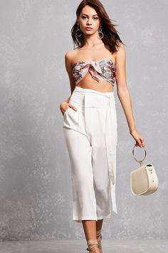 A pair of woven cropped pants featuring an attached self-tie belt, slanted front pockets, mock back welt pockets, a concealed zip fly, an interior lining, and a wide straight-leg design.<p>- This is an independent brand and not a Forever 21 branded item.</p>