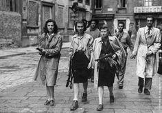 Italian partisans associated with the Partito d'Azione during the liberation of Milan. 1945