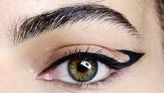 Graphic winged liner by Val Garland at Hervé Léger Fall/Winter 2014