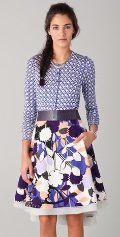 Love the mix and match of patterns. I am not comfortable wearing them but i love it on some people...