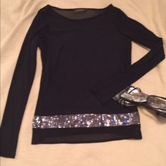 The Limited Party Shirt Beautiful black shirt with shimmer band around bottom. Sleeves and upper part of shirt are sheer. Body of shirt is jersey type material. Perfect piece for a night on the town! Worn once. The Limited Tops Blouses