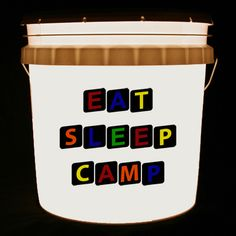 This bucket light features the words EAT SLEEP CAMP.