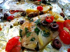 Grilled Tilapia with garlic, tomatoes, olives, lemon and capers.  Also grilled artichokes. The Thrill of the Grill! - Proud Italian Cook