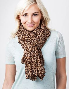 How To Tie a Scarf @ Scarves.com Great site for buying scarves and pashminas that also has tying tutorials.