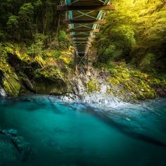 Blue Pools Walk, Mt Aspiring National Park, New Zealand — by Chrystal Hutchinson. The bridge that leads you over the stunning Blue Pools, which really are this blue! It's amazing