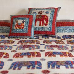 Elephant cotton appliqué bedspread in rich red & bold blue colours, finished with a detailed border on a natural coloured background. Charmed Characters, Applique Cushions, Elephant Applique, Colourful Cushions, Bed Spreads, Red Colour, It Is Finished, Colours, Throw Pillows