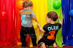 The twins first birthday photo shoot. You can use any wall in your house and create a rainbow background with streamers. This is a perfect way to celebrate a childs 1st birthday and get some awesome pictures.