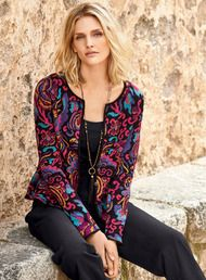 A 19th century Chinese embroidered textile was the muse for this rich floral, cast in vibrant jewel tones of pima on a ground of black. A polished jacket alternative, the jacquard knit cardigan is minimally styled with a round neck, patch pockets and 5-button placket.