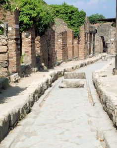 Stepping stones in the streets of Pompeii: allowed people to cross the street without stepping in the road muck -- AND stepping stones were all a regulated size so wagons could pass over them.