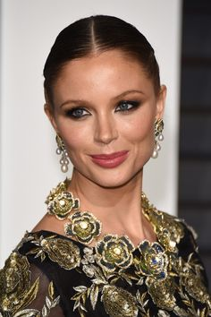Georgina Chapman's floral necklace and pearl earrings was just the right finish to her gilded Marchesa gown.