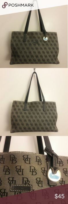 Dooney & Burke bag Used but in good condition, a little  make-up spilled inside middle zipper part, but not dramatic. 13 inch long, 8 inch tall Dooney & Bourke Bags Totes