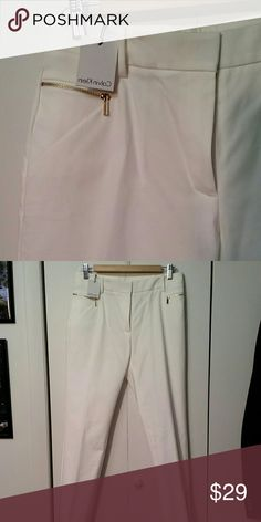 White Calvin Klein pants New pants with gold zippers on pockets and ankles. Sturdy fabric with flattering cut. Classy yet comfortable! Calvin Klein Pants