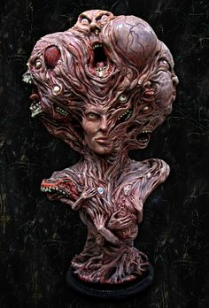 A four feet tall Clive Barker collaboration sculpture. Clive named it; Proteath, The Lord of Changes. If it were alive, each of the faces or appendages would be writhing in a desperate attempt to escape their smug, perverted captor. Artist: Jason Hite