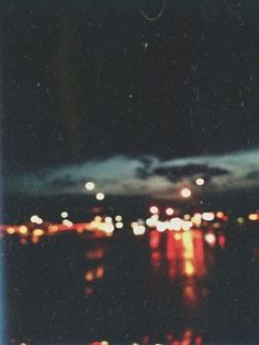 city lights, esp at night in the distance, on the water. <3