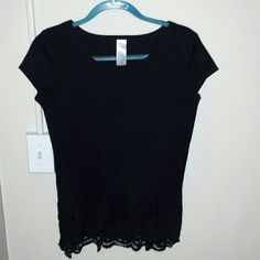 NWOT Avon Black Lace Top The tag says small, but it fits more like a medium in my opinion. Nice lace bottom, kind of like a peplum top. The shirt is brand new, I only tried it on once. Avon Tops Blouses
