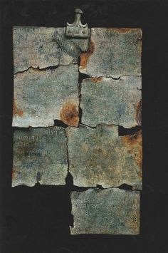 200 BCE. The Tabula Cortonensis, a bronze plaque with 8 pieces and riveted handle. It may be a contract related to the division of realty and chattel. It is a primary resource for the etruscan language with 34 known words and an equal number of previously unattested Etruscan words. The  Ǝ (a reversed epsilon) implies that, at least in the Etruscan dialect spoken in Cortona has a different sound  than E. 32 horizontal lines of text, about 30 letters long on the front and 8 on the back.