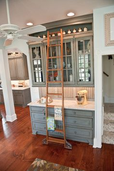 cabinet with library ladder | traditional kitchen by Ironwood Cabinet Design