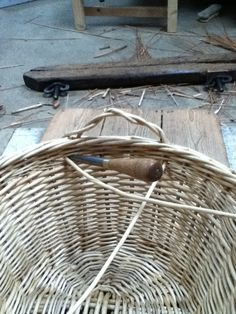 Using the bodkin to help with the making of the handles on a washing basket. Basket Weaving, Hand Weaving, Living Willow, Washing Basket, Big Basket, Wicker, Baskets, Board, Bushel Baskets