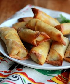 Egg roll wrappers stuffed with cheese, chicken, onions, and cilantro and baked until crisp