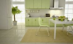 light green kitchen cabinets and dining chairs