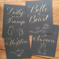 Table names for an @esla_events wedding. Disney couples, with non-copyright-infringing illustrations! gold gouache on slate paper #calligraphy #illustration #disney