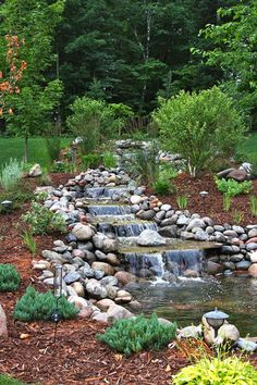 a Waterfall Garden These unique water features bring a spirit of adventure to your backyard.These unique water features bring a spirit of adventure to your backyard.