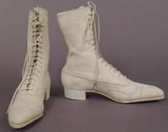 """High laced white suede/buck sports shoes with perforated strip design, American, 1920. Label: """"Frank Brothers Fifth Ave. N.Y."""" Date of 4/26/20 on left sole."""