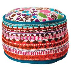 Add a pop of pattern to your living room or master suite with this lovely cotton pouf, showcasing a geometric floral motif.   Produc...