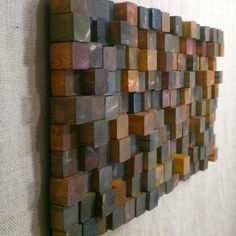 Wandkunst modern aus recyceltem Holz-Klötzchen