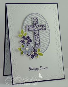 emboss border inside as well as outside. cut out oval, place patterned paper underneath and cut out embossed cross in white.